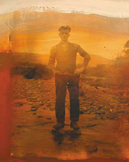 Man standing on rand sand with orange filter